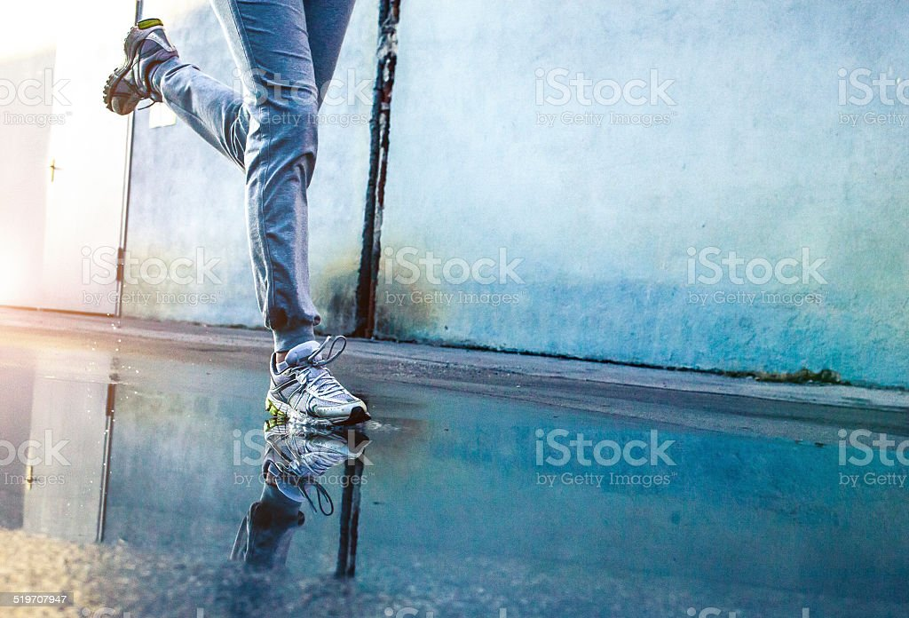 Woman's Athlete feet on the road stock photo