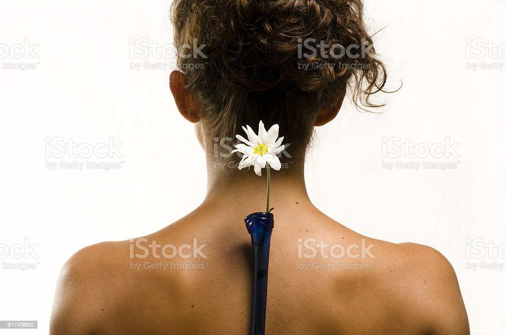 """Woman """"s back avec fleur blanche photo libre de droits"""