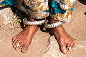 woman's bare feet with toe-rings and silver ankle bracelets