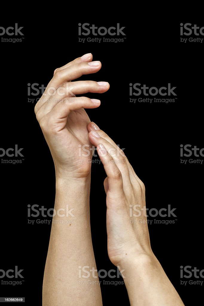 Woman's beautiful hands on black background royalty-free stock photo
