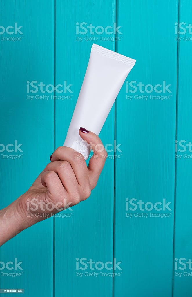 Woman's beautiful hands with care cream tube stock photo