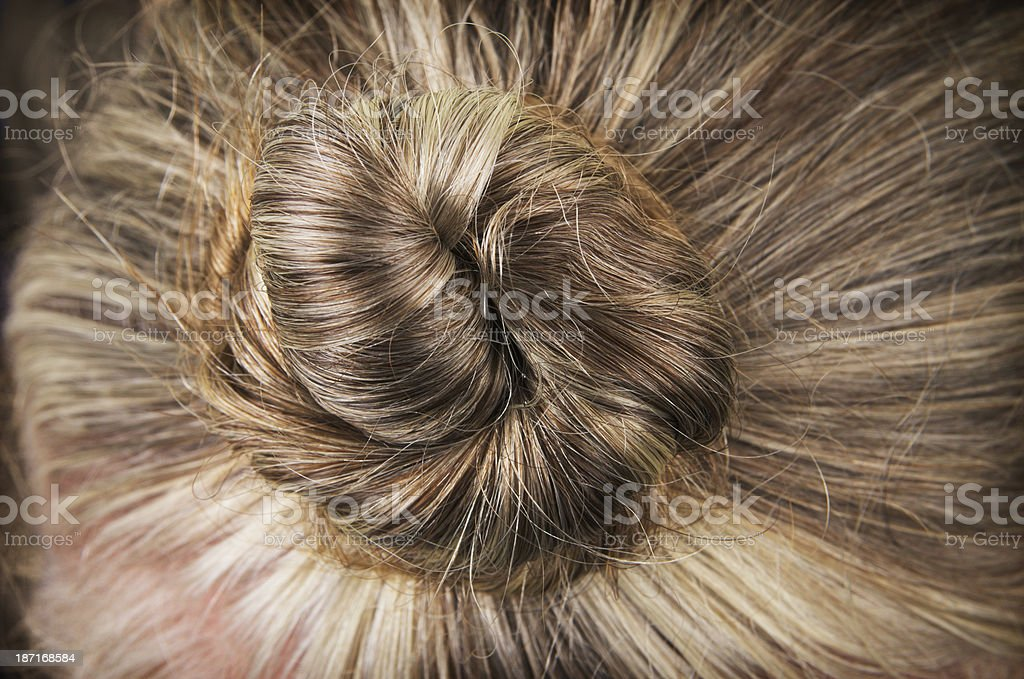 Womans Blonde hair In Topknot royalty-free stock photo
