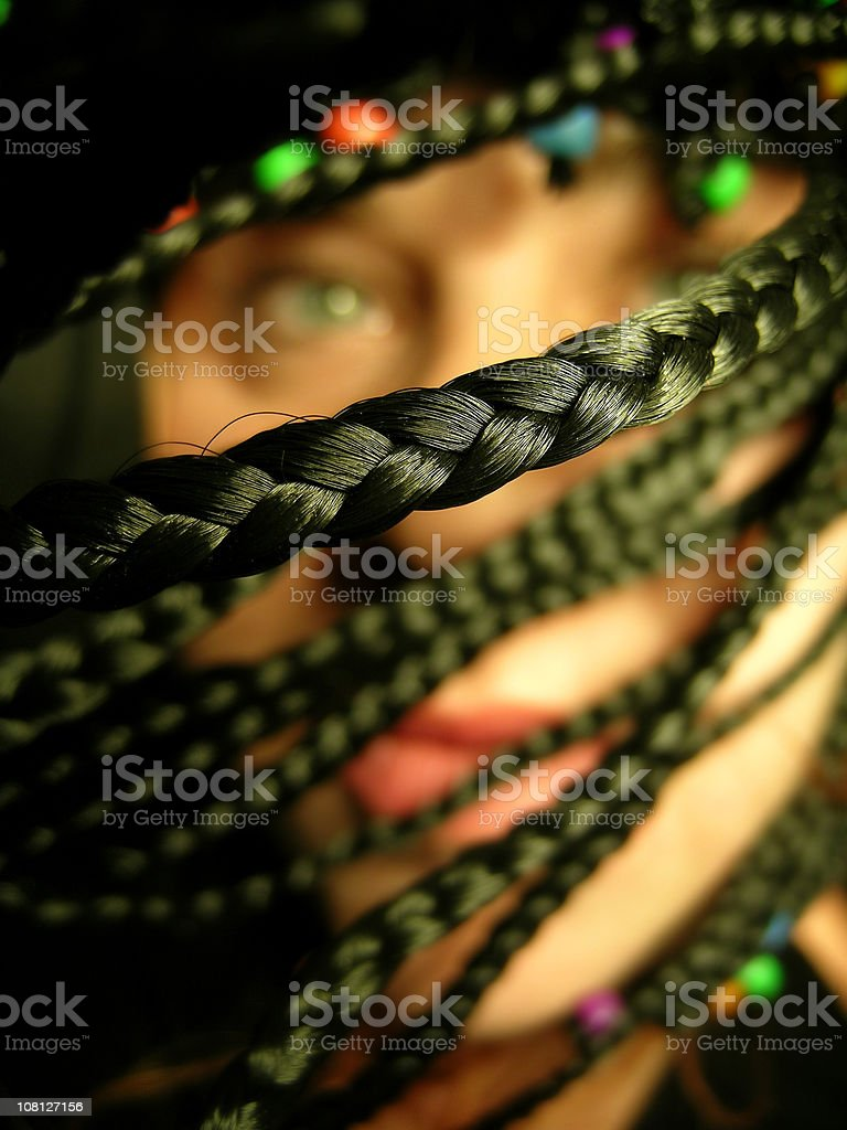 Woman's Braided Hair with Beads royalty-free stock photo
