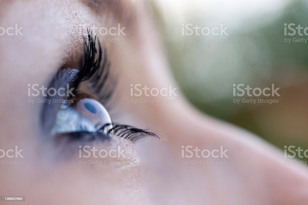 A woman's brown eye looking up royalty-free stock photo