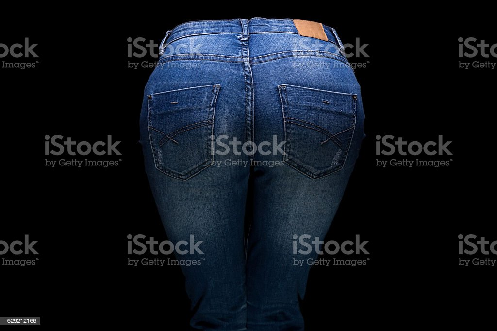 Woman's buttocks and blue jeans stock photo