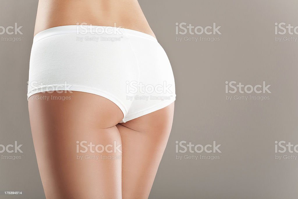 A woman's buttocks in a boy short white brief underwear royalty-free stock photo