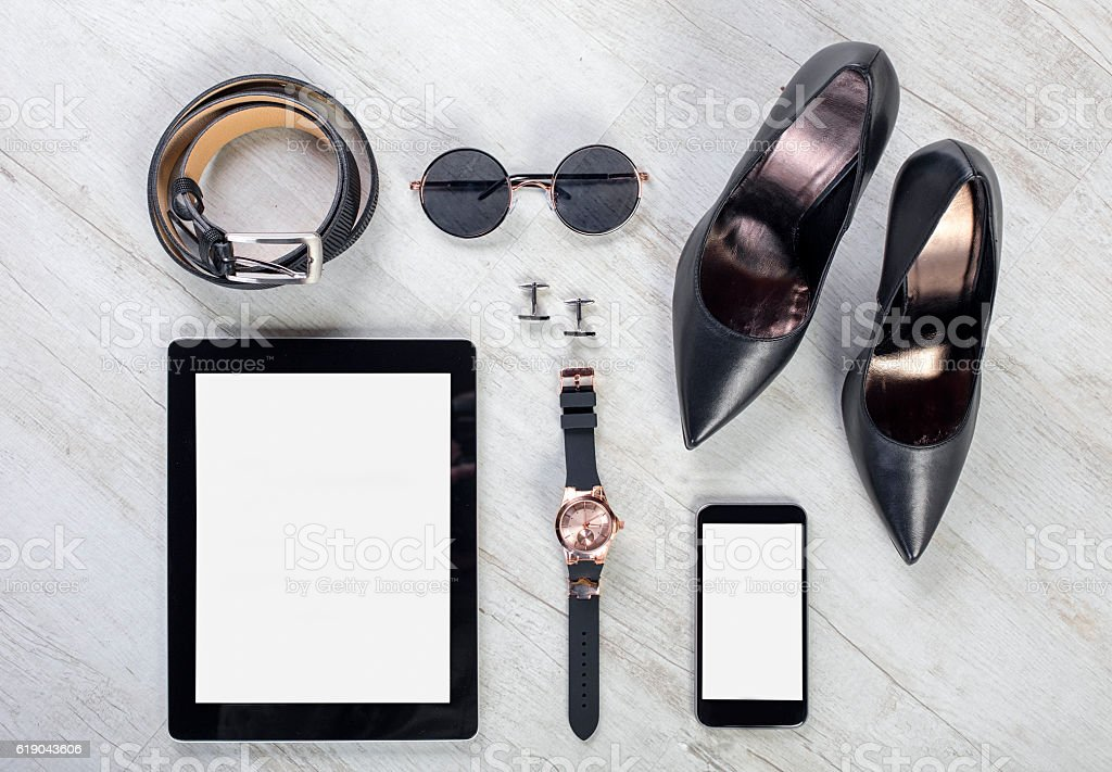 woman's casual business accessories organized on table stock photo