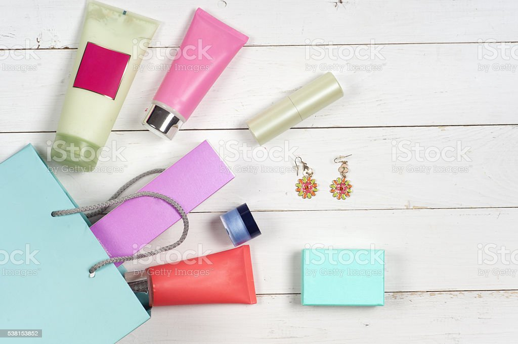 Woman's cosmetics and accessories on wooden background. stock photo