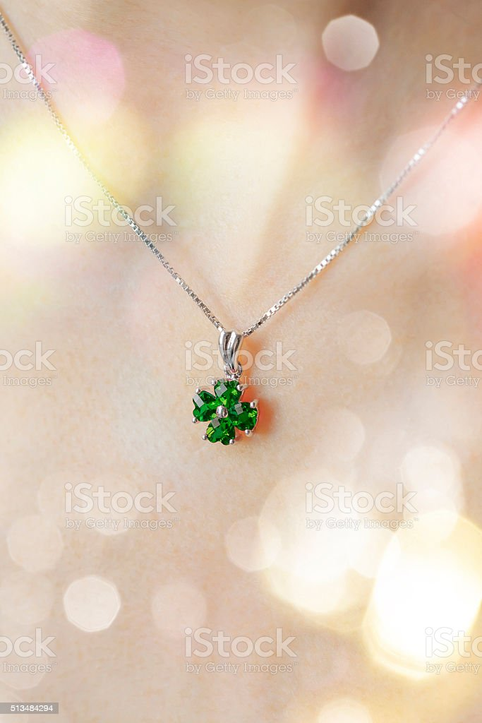 Woman's decollete with a pendant stock photo