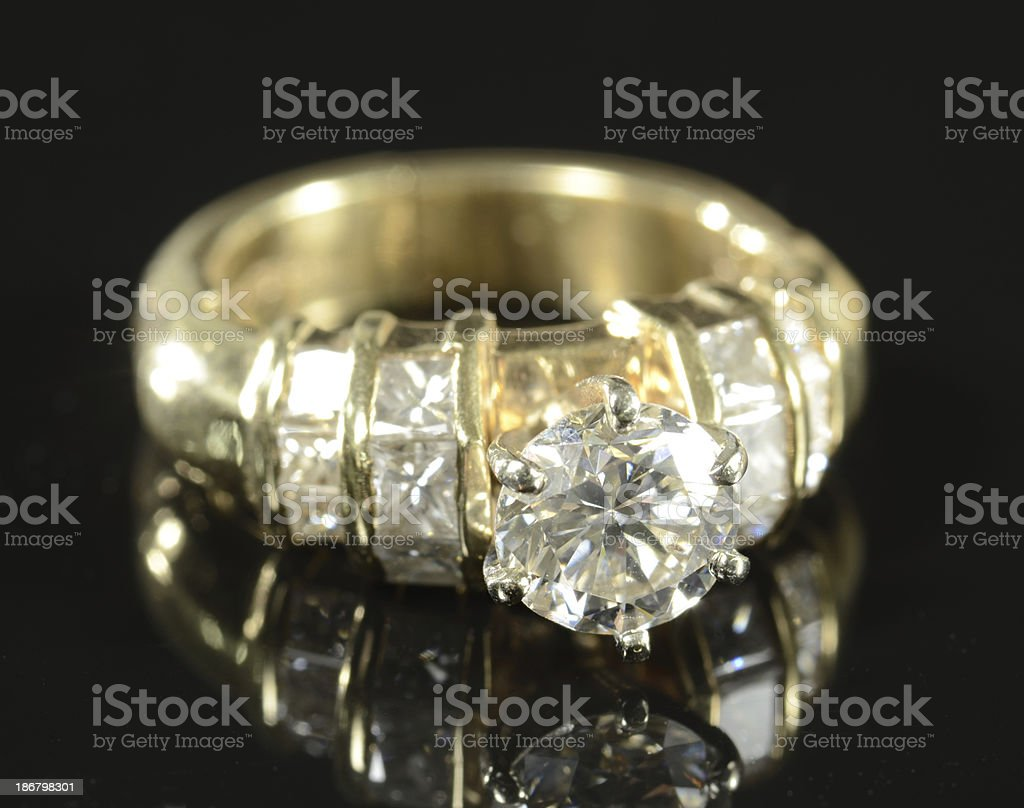 Woman's Diamond and Yellow Gold Wedding Ring royalty-free stock photo