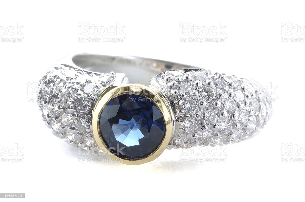 Woman's Diamond, Sapphire and Gold Ring royalty-free stock photo