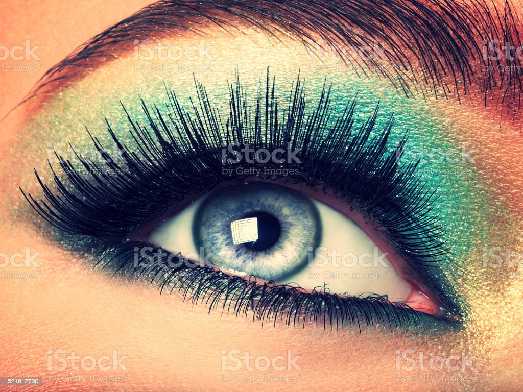 Woman's eye with green make-up. Long eyelashes stock photo