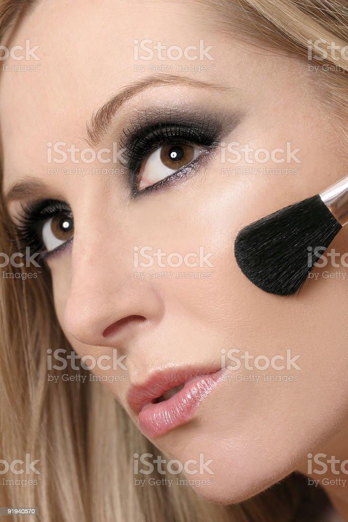 Woman's face and makeup brush royalty-free stock photo