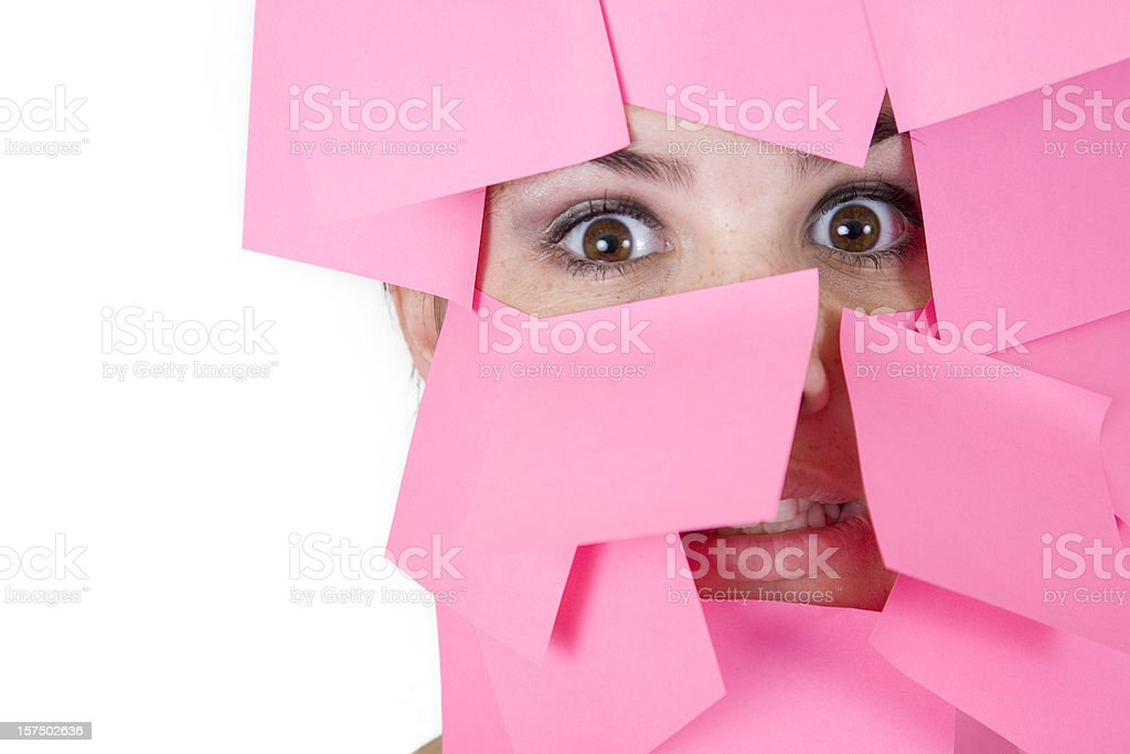 Woman's Face Covered in Pink Sticky Notes royalty-free stock photo