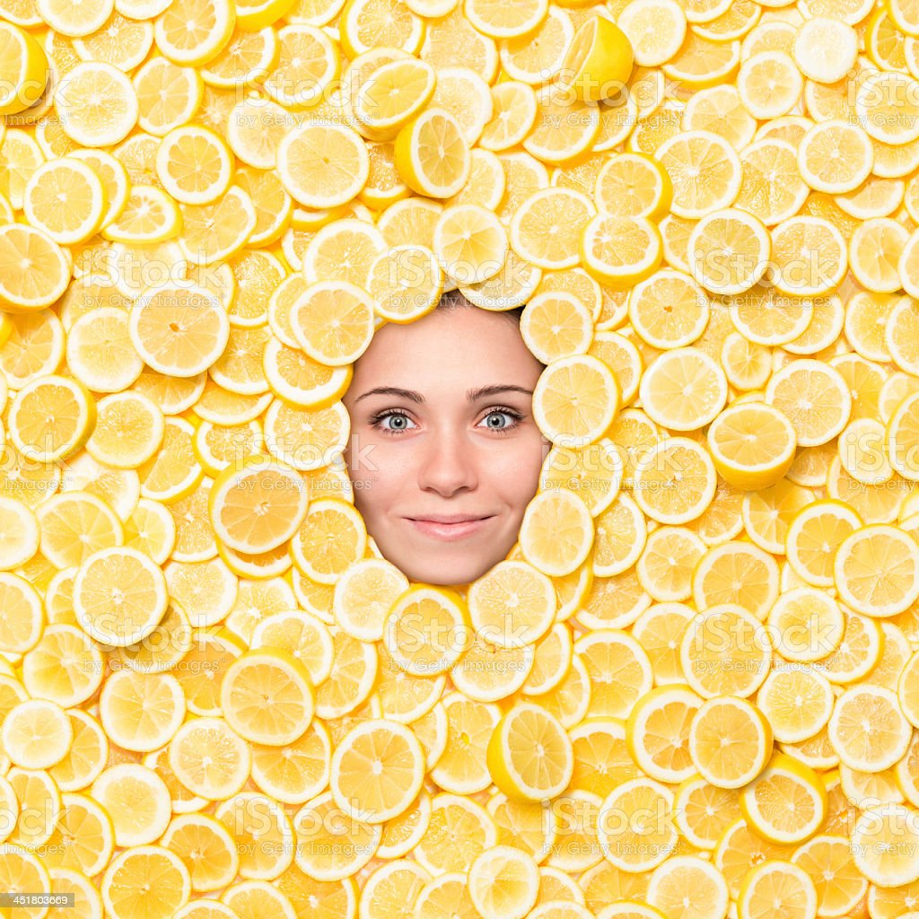 Woman's Face Surrounded With Lemon Slices stock photo