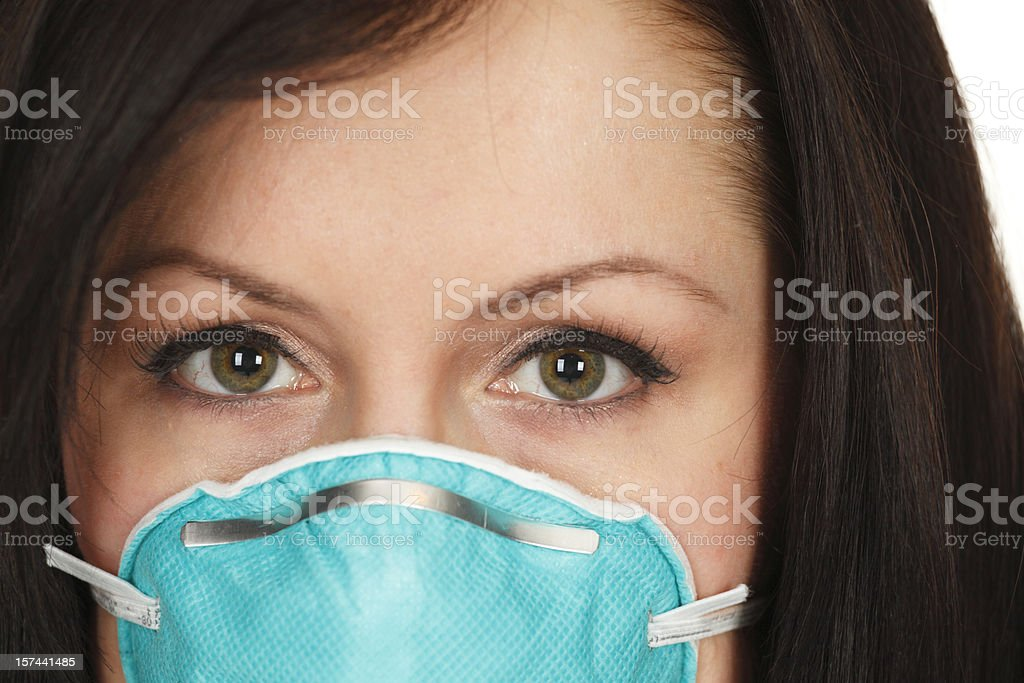 Woman's Face with Surgical Mask royalty-free stock photo