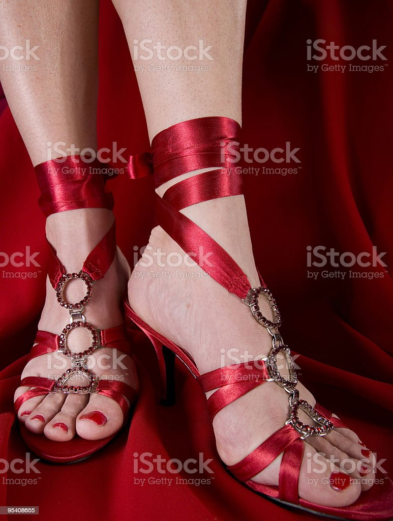 Woman's feet in sexy shoes stock photo