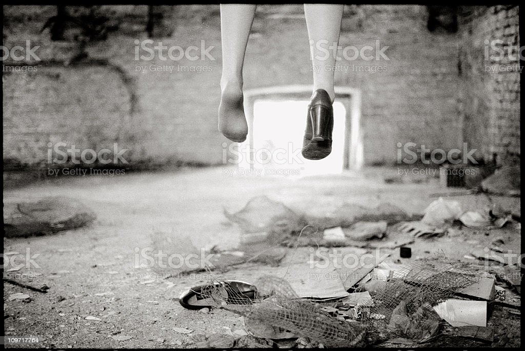 Woman's Feet Missing One shoe in Abandoned Building royalty-free stock photo
