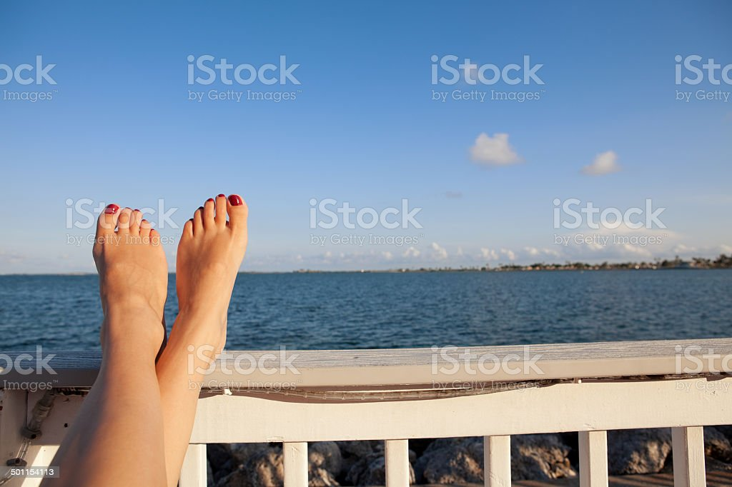 Woman's Feet Relaxing By Bay stock photo