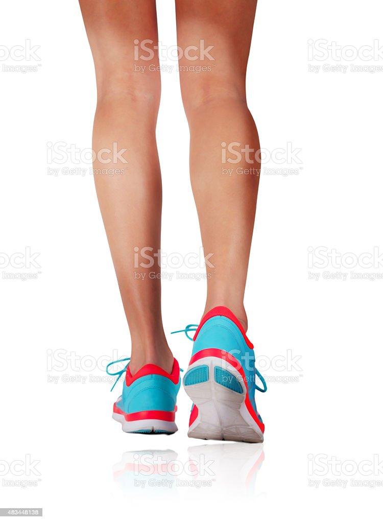 Womans feet running in studio stock photo