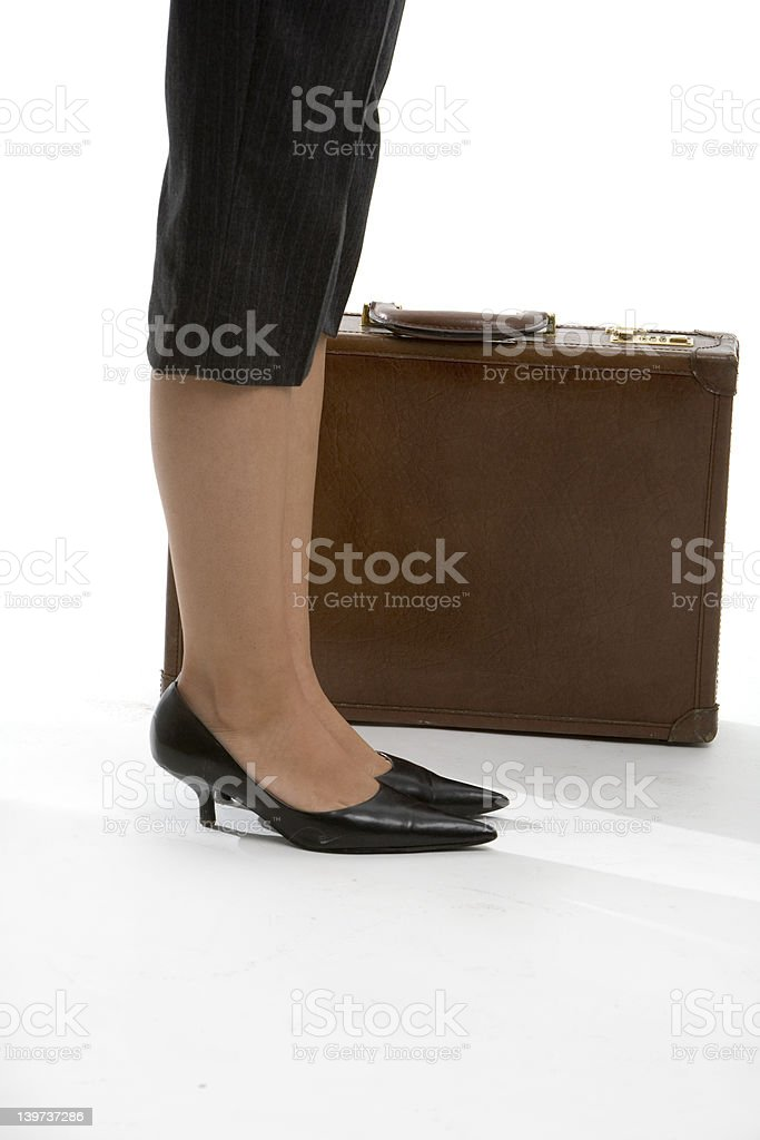 Woman's feet with brief case stock photo