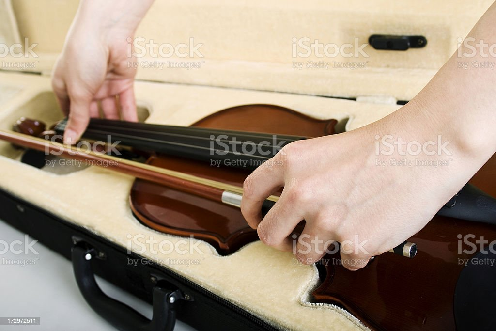 womans hand and violin in case stock photo