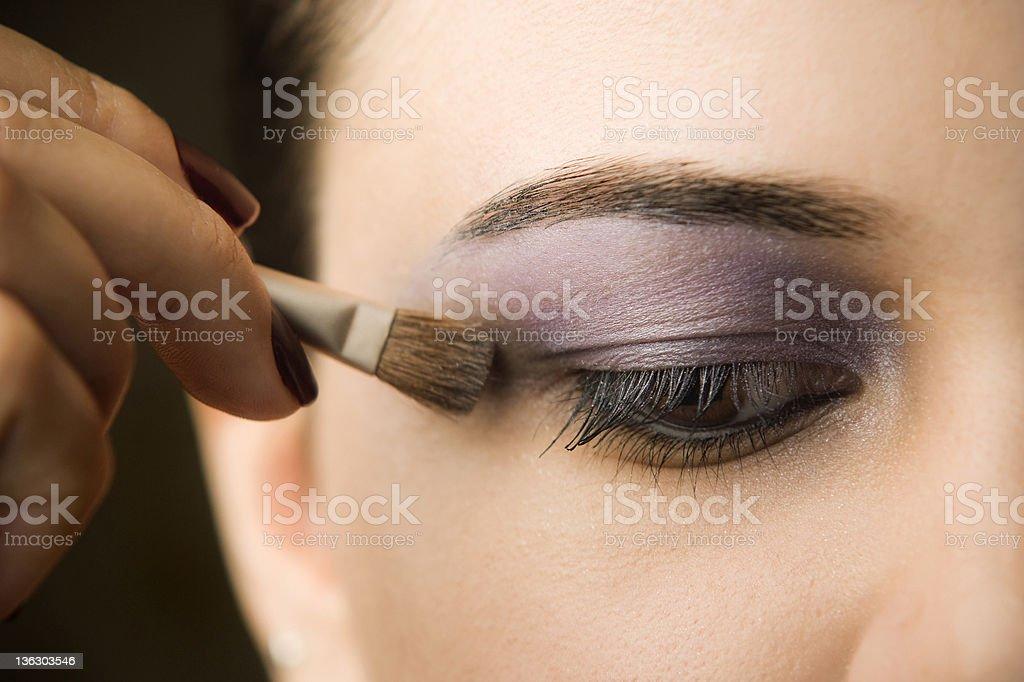 Woman's hand applying makeup brush to eyes royalty-free stock photo