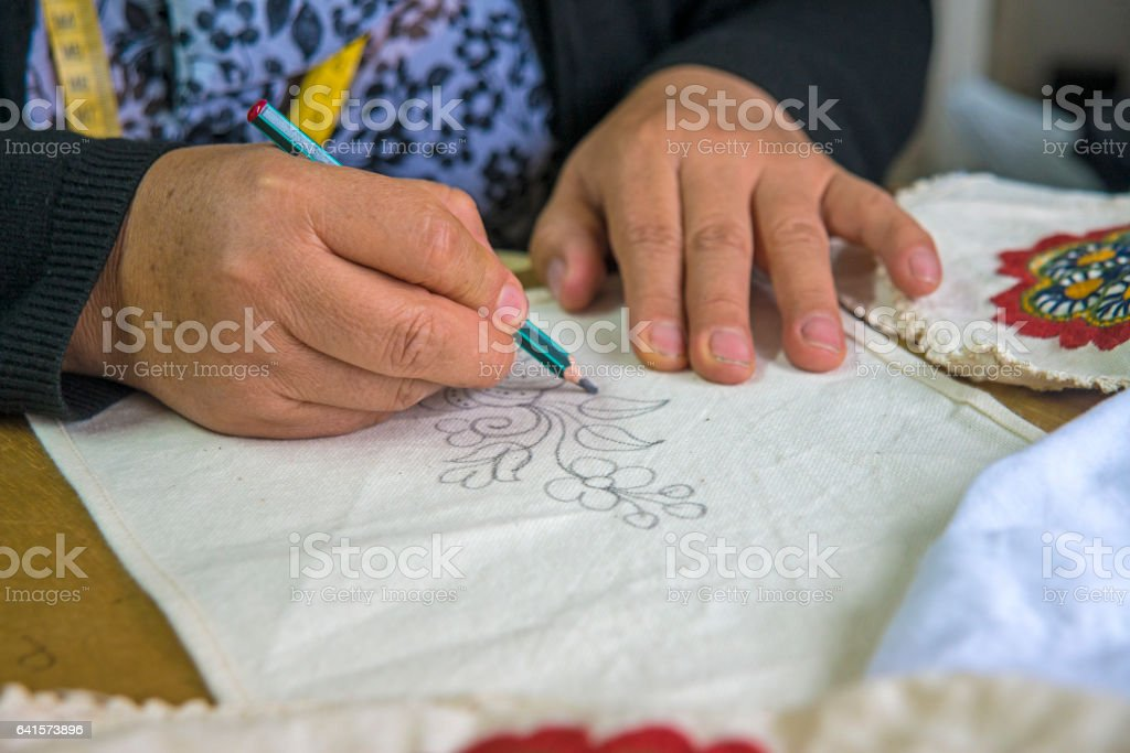Woman's hand drawing stock photo