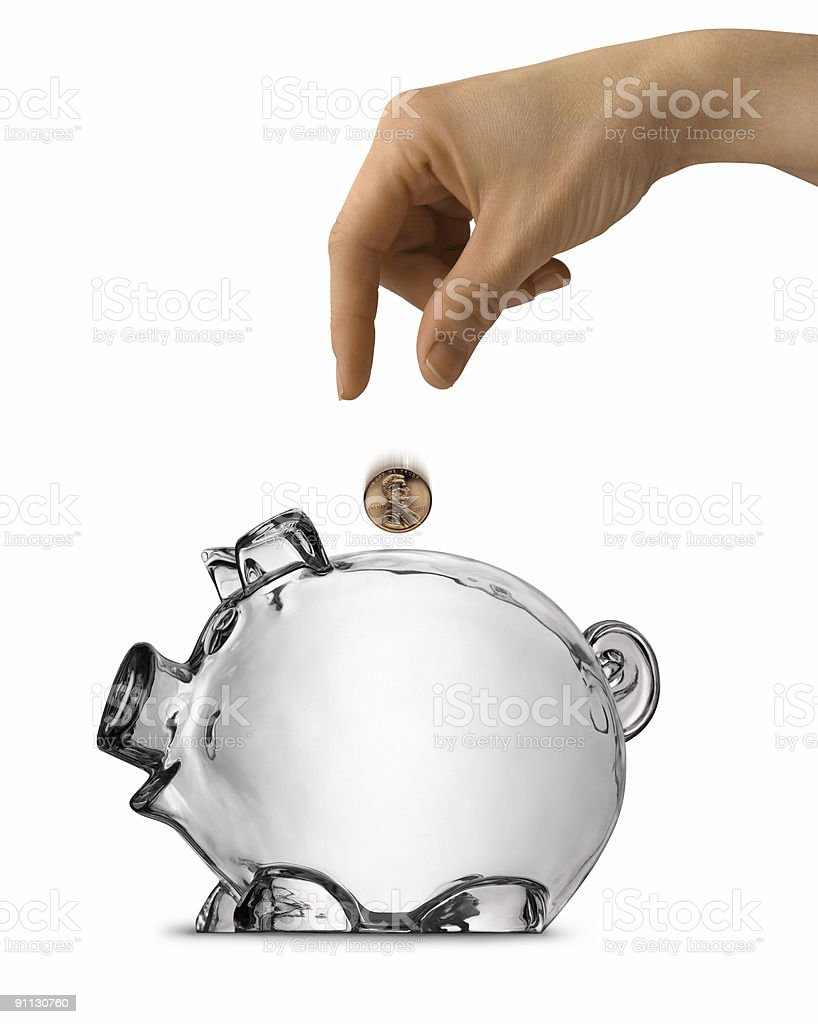 Womans Hand Dropping Coin Into Empty Piggy Bank Isolated royalty-free stock photo