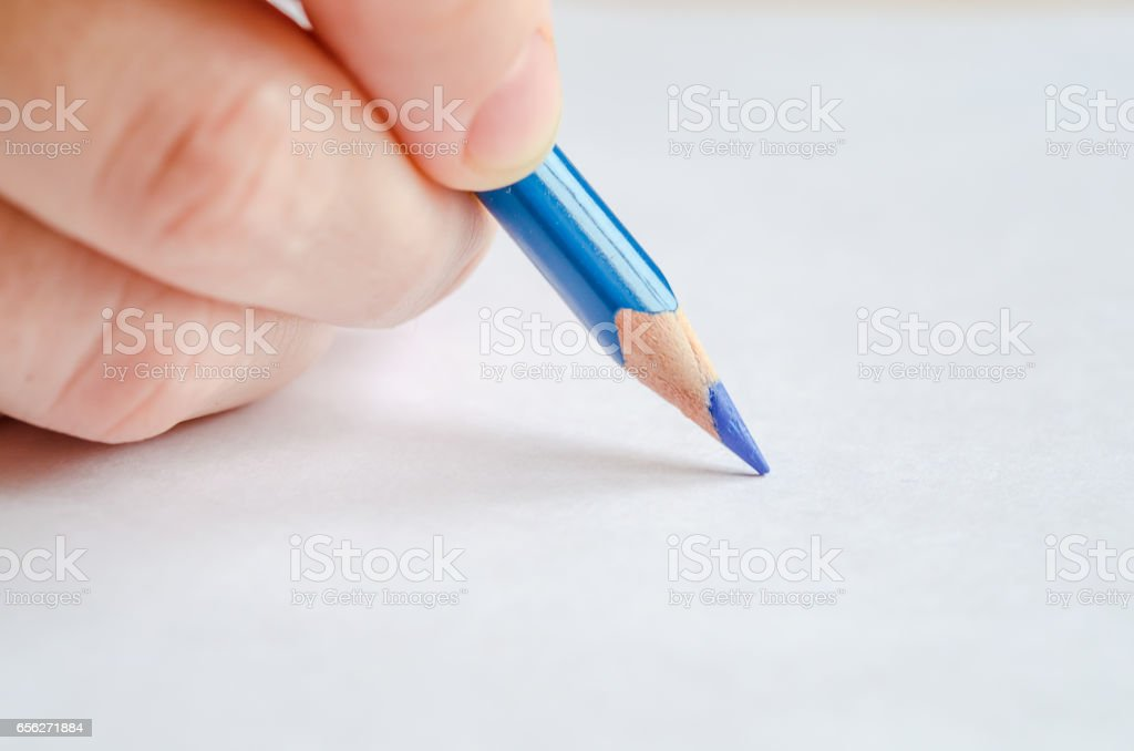 Woman's hand holding a pencil on white stock photo