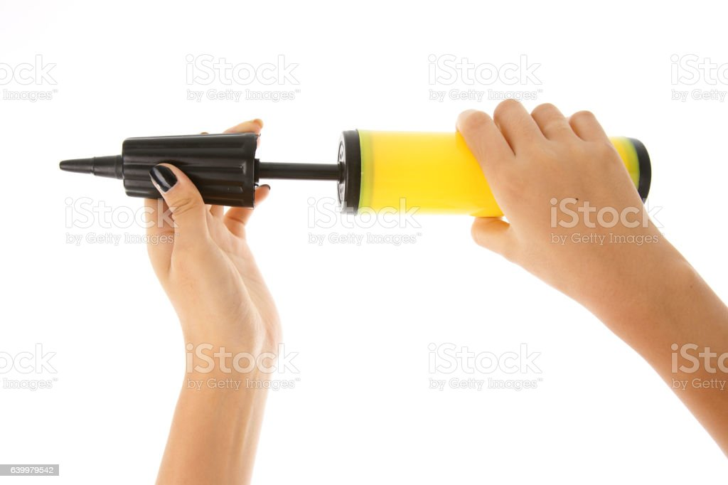 Woman's hand holding an air pump on white background stock photo