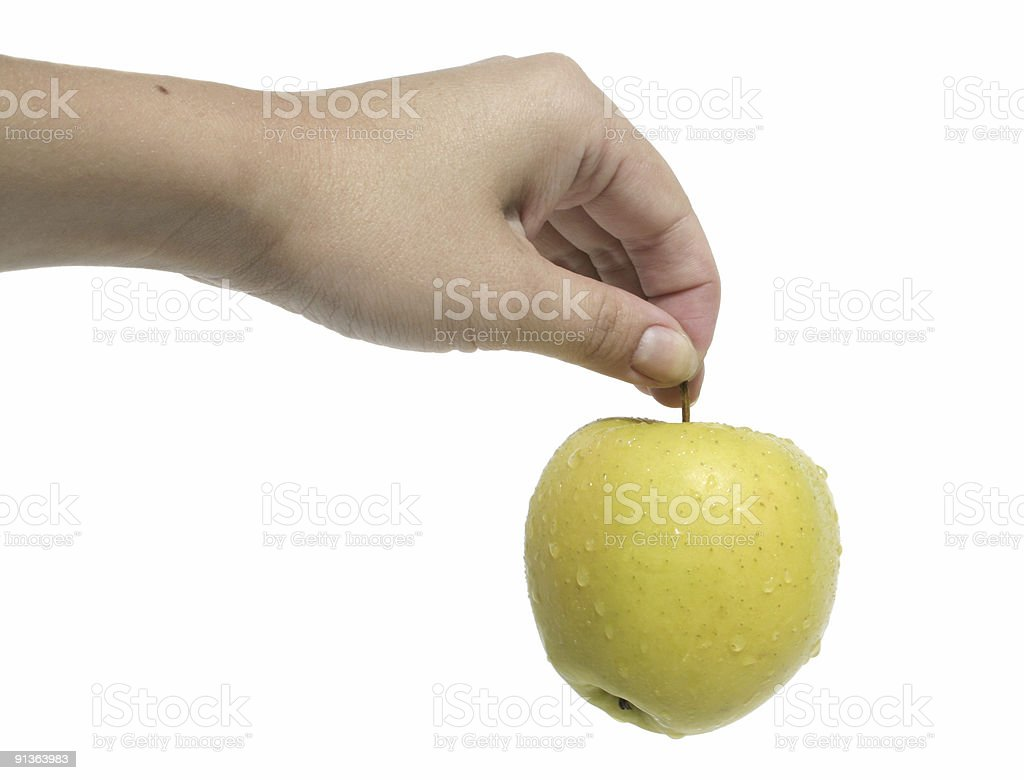 Woman's hand holding an apple royalty-free stock photo