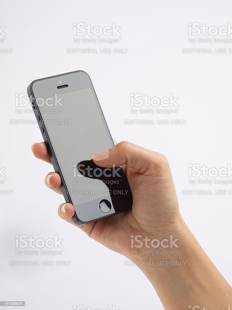 Woman's Hand Holding An iPhone 5 stock photo