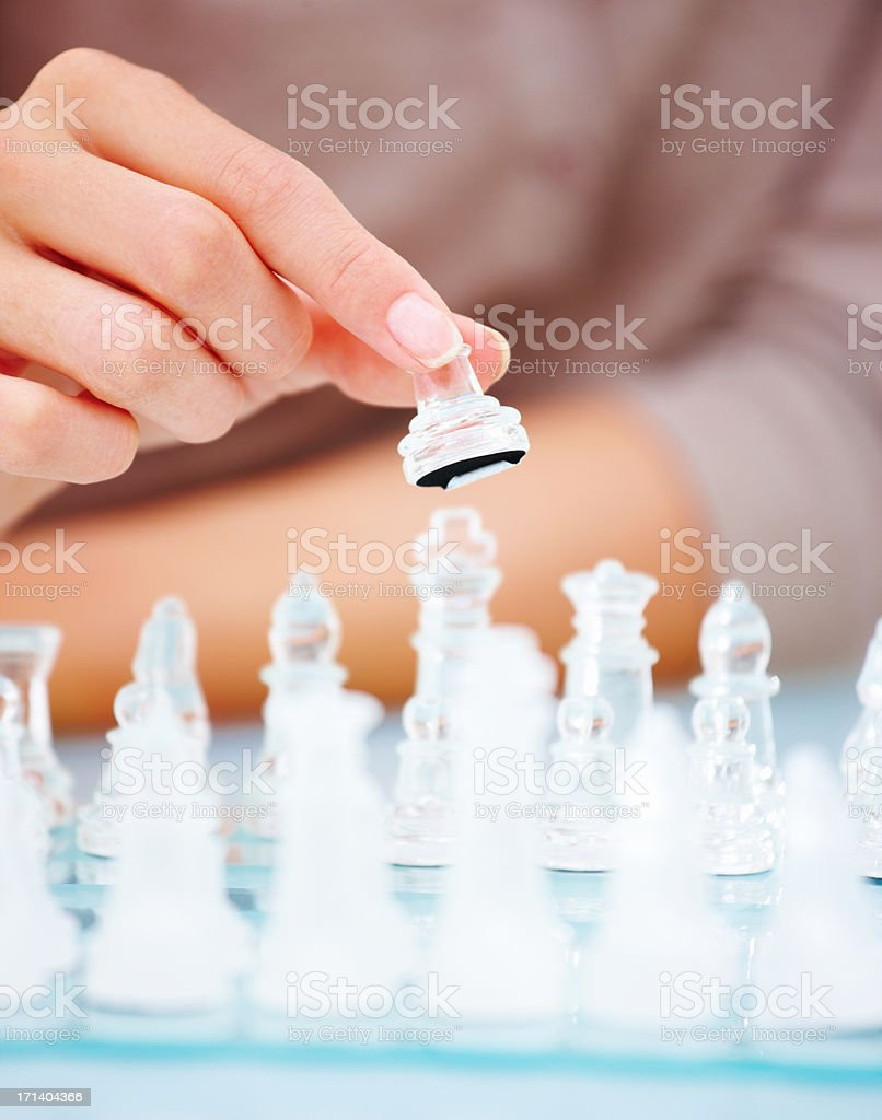 womans hand holding chess piece. royalty-free stock photo