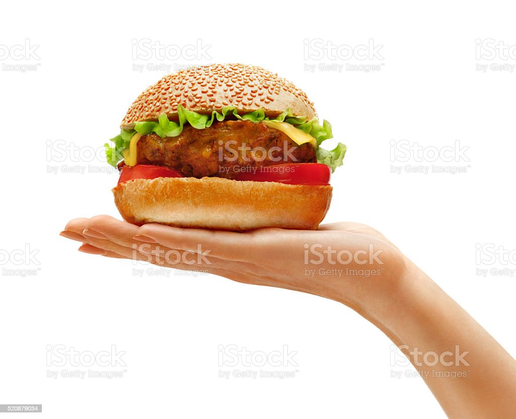 Woman's hand holding tasty hamburger stock photo