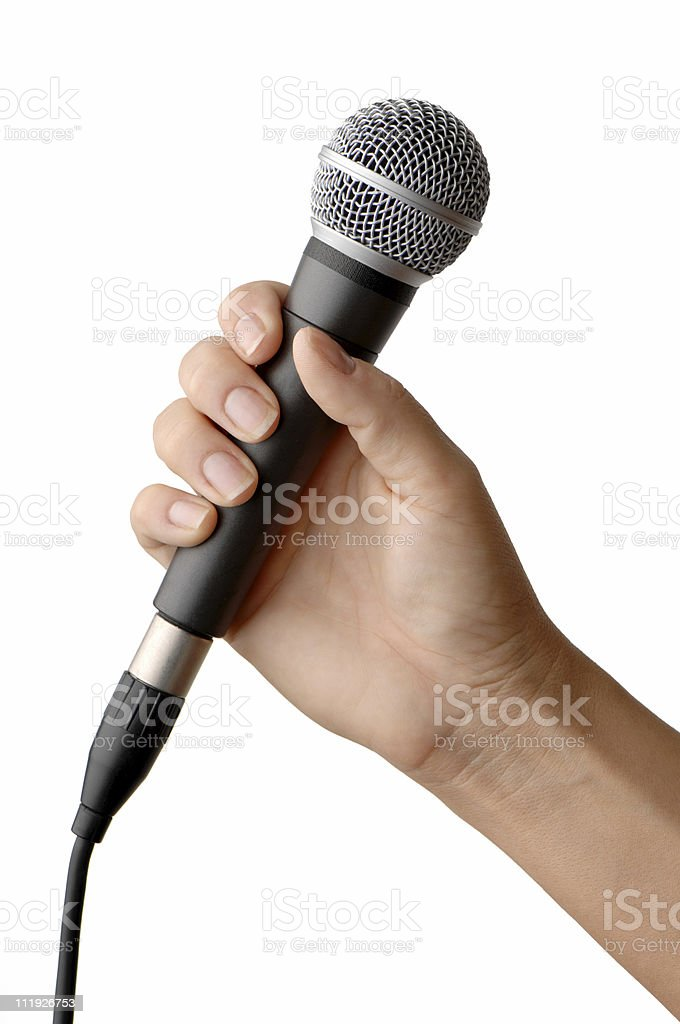 Woman's Hand Holding Vocal Microphone Isolated on White Background stock photo