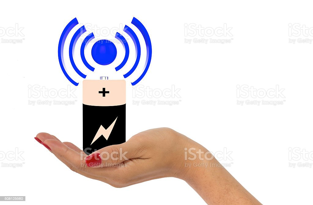 Woman's hand holding wireless charging icon stock photo