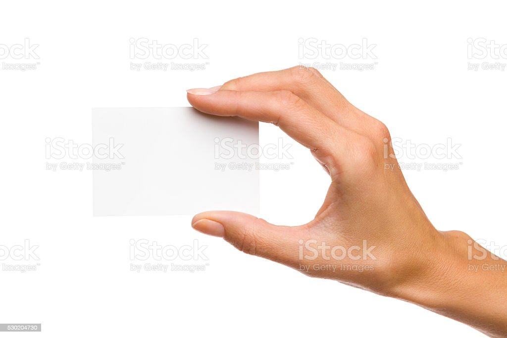 Woman's Hand Holds White Card stock photo