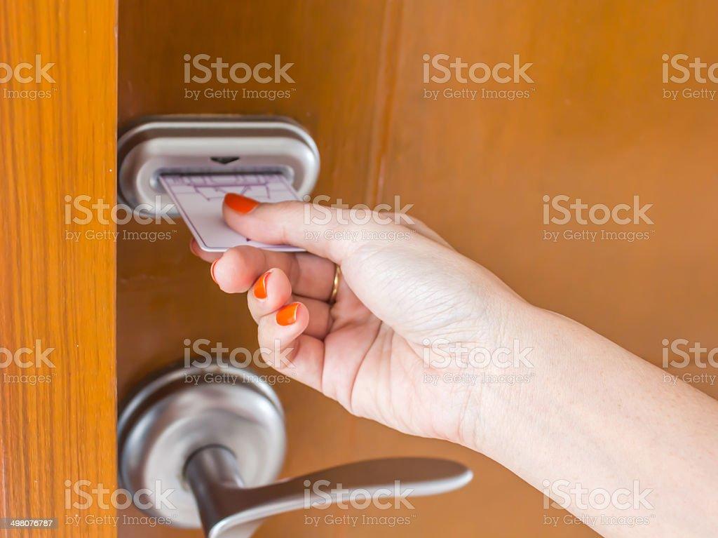 woman's hand inserting key card stock photo