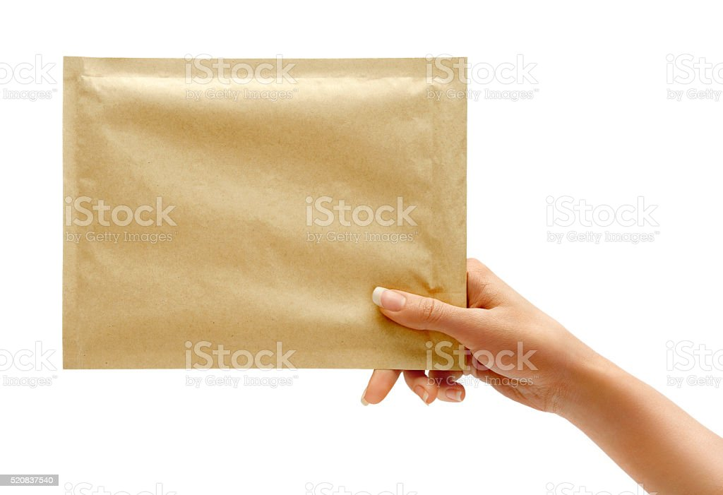 Woman's hand is giving envelope. stock photo