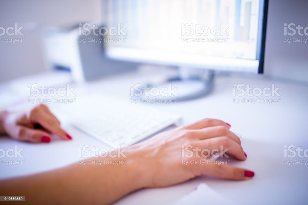Woman's hand on cursor and keyboard stock photo