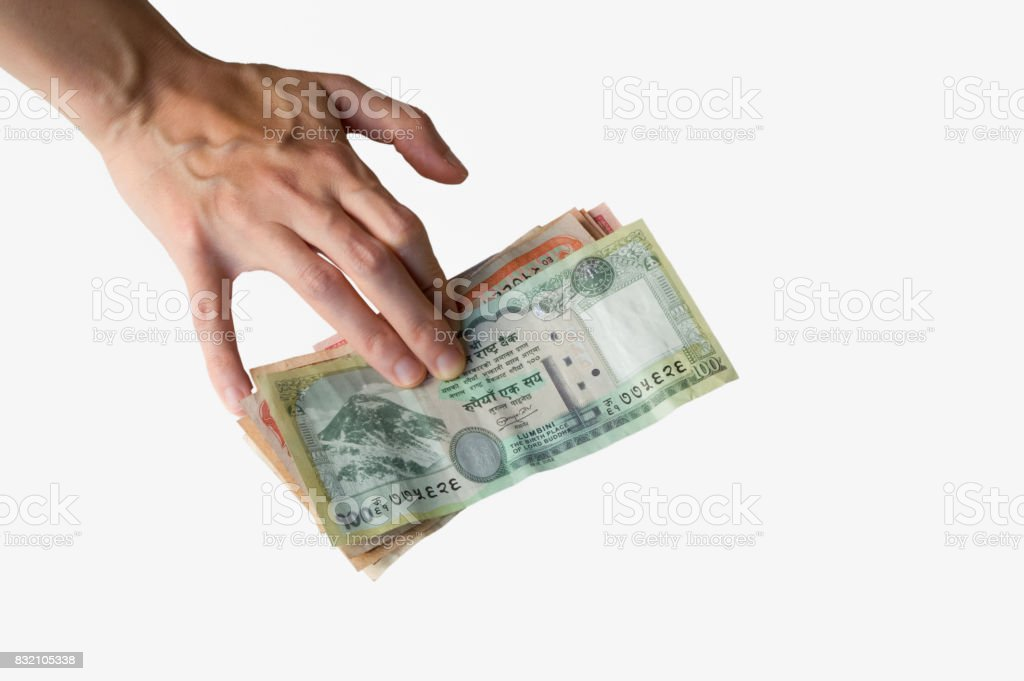Woman's hand on Nepal Rupees notes stock photo