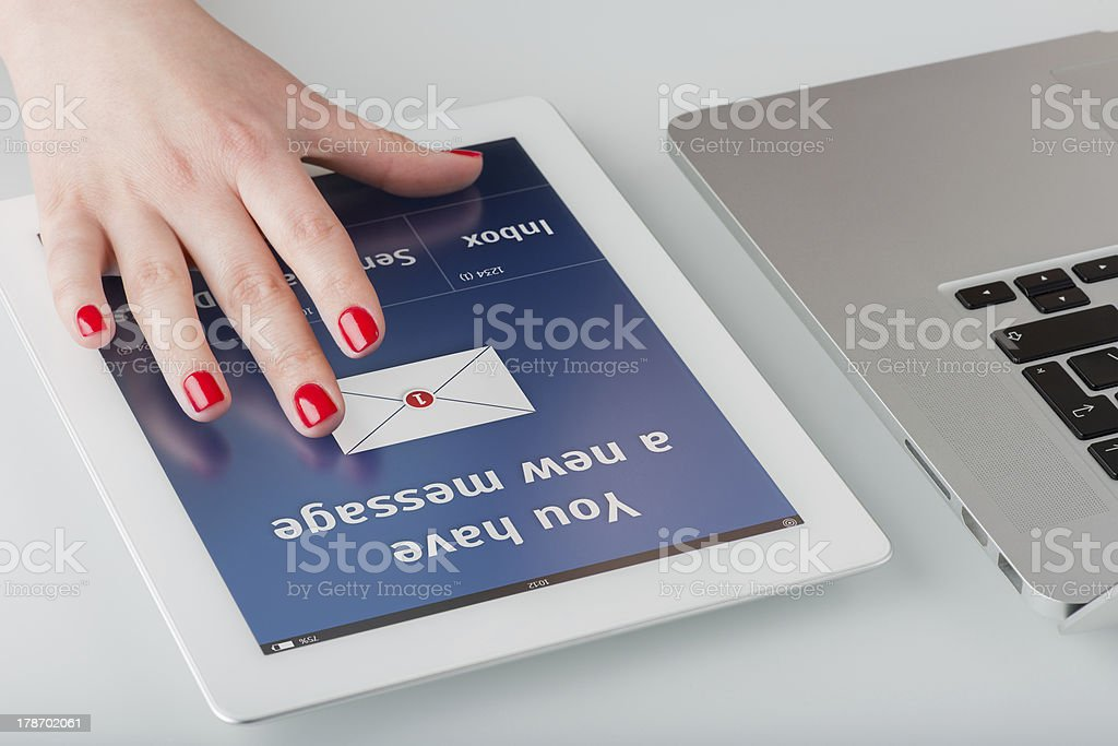 Woman's hand on the tablet computer. stock photo