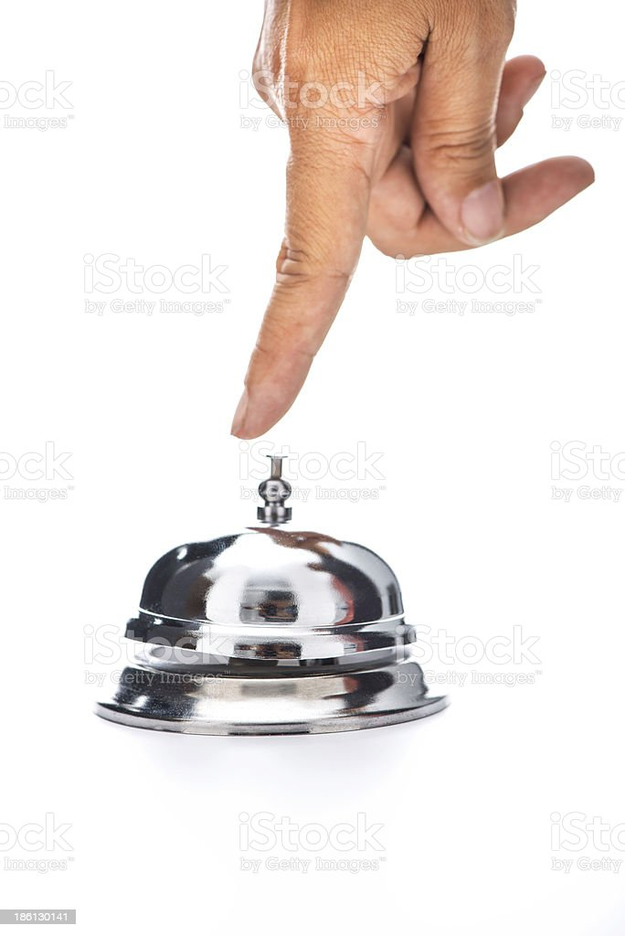 Woman's hand ringing hotel bell stock photo