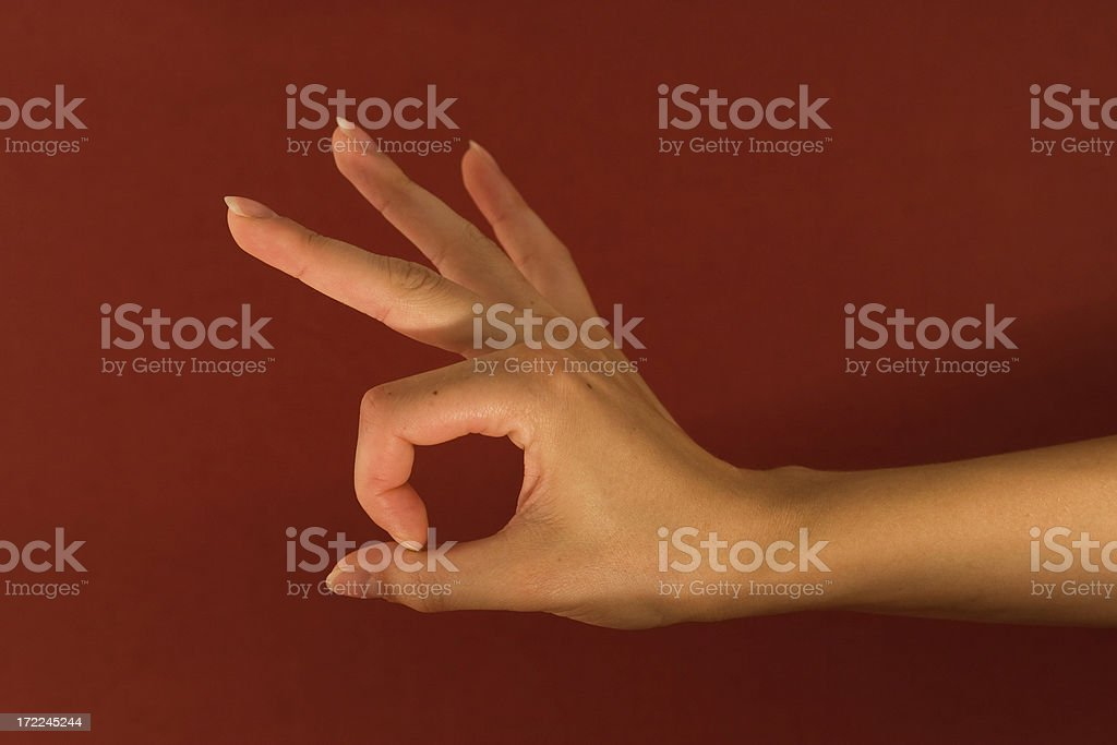 woman's hand showing 'perfect' royalty-free stock photo