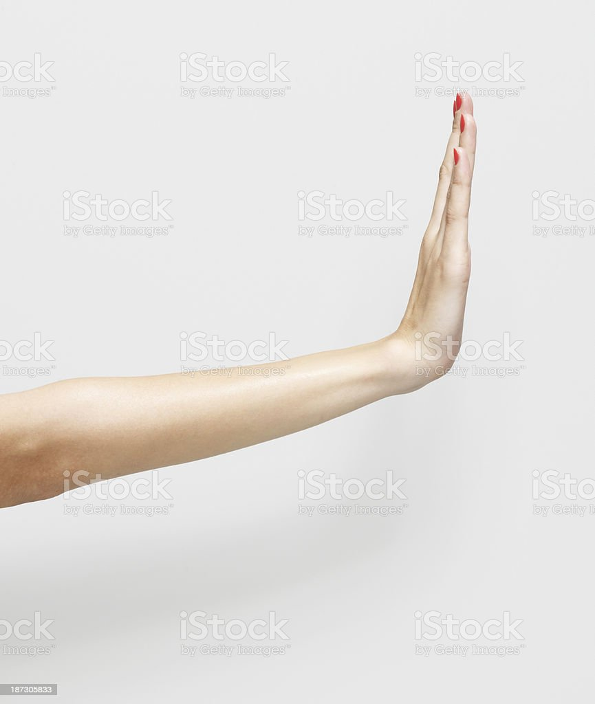 Womans hand showing stop gesture stock photo