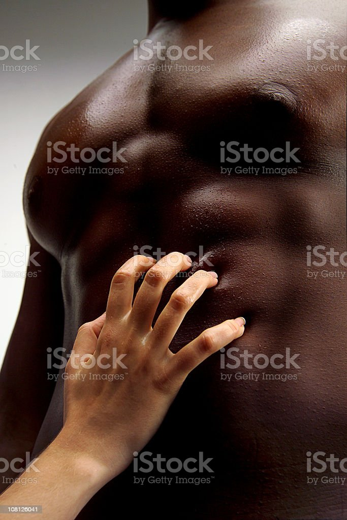 Woman's Hand Touching Shirtless Man's Stomach royalty-free stock photo