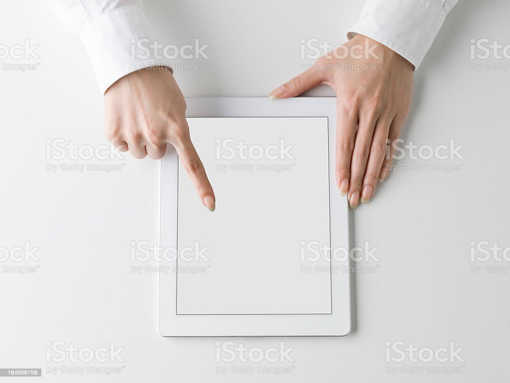 Woman's hand touching the Tablet PC royalty-free stock photo