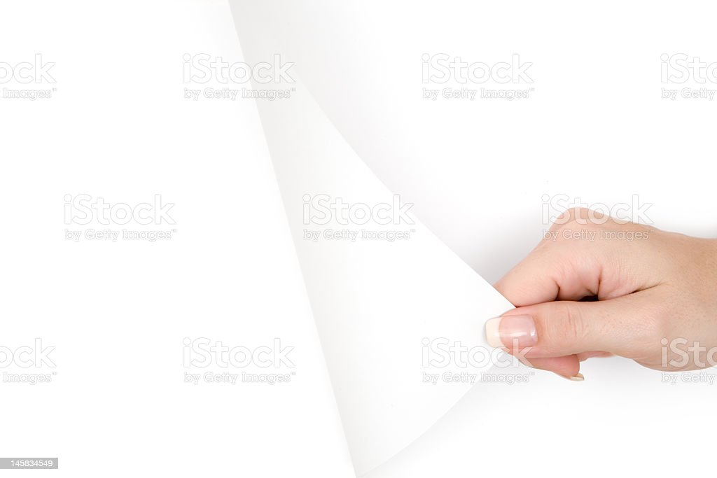 Woman's hand turning a blank page stock photo