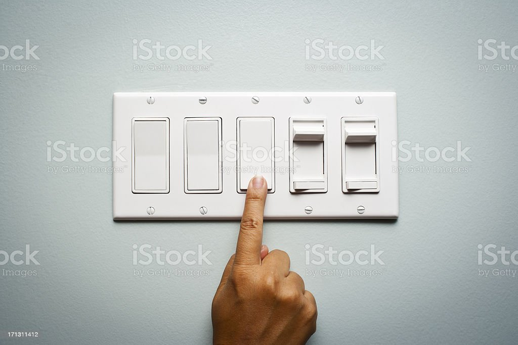 Woman's hand turning off the light royalty-free stock photo